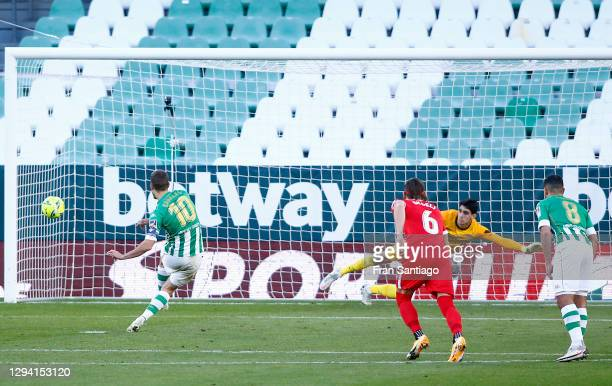 Sergio Canales of Real Betis scores their team's first goal from the penalty spot during the La Liga Santander match between Real Betis and Sevilla...