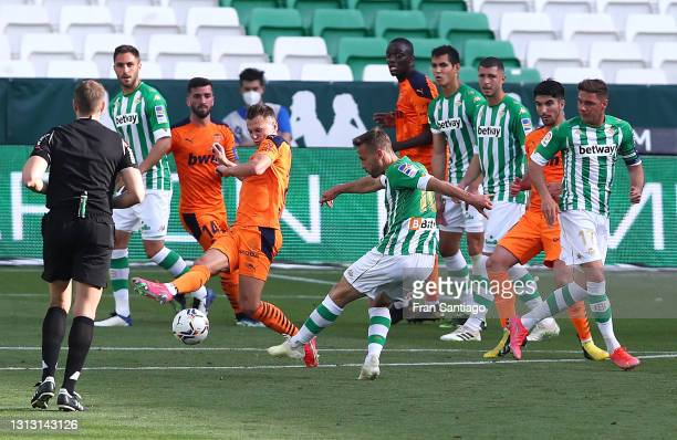 Sergio Canales of Real Betis scores their team's second goal during the La Liga Santander match between Real Betis and Valencia CF at Estadio Benito...