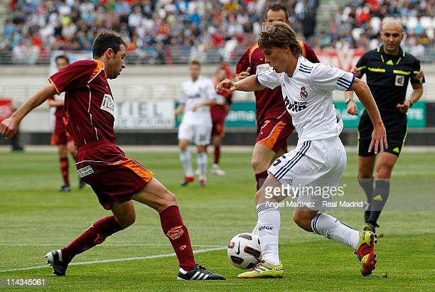 Sergio Canales of Real Madrid duels for the ball with Olivares of Murcia during the benefit match for victims of recent earthquake in Lorca between...
