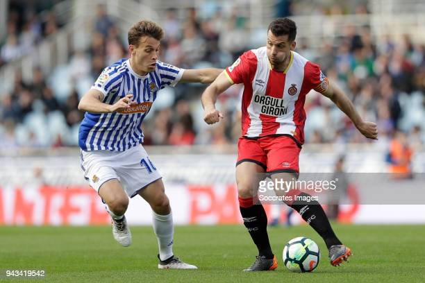 Sergio Canales of Real Sociedad Alex Granell of Girona during the La Liga Santander match between Real Sociedad v Girona at the Estadio Anoeta on...