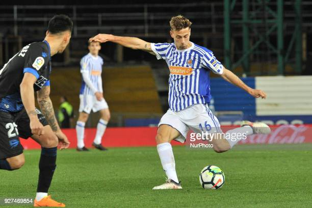 Sergio Canales of Real Sociedad duels for the ball with Hernan Perez of Alaves during the Spanish league football match between Real Sociedad and...