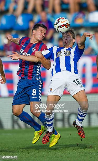 Sergio Canales of Real Sociedad duels for the ball with Jon Errasti of SD Eibar during the La Liga match between SD Eibar and Real Sociedad at Ipurua...