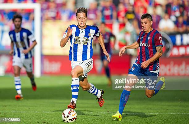 Sergio Canales of Real Sociedad duels for the ball withAbraham MInero of SD Eibar during the La Liga match between SD Eibar and Real Sociedad at...