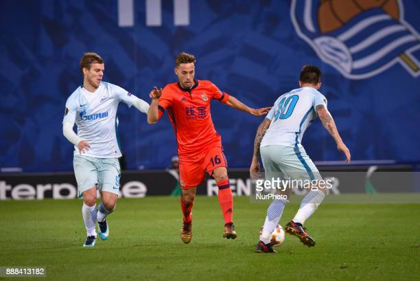 Sergio Canales of Real Sociedad vies with Aleksandr Kokorin and Emiliano Rigoni of Zenit during the UEFA Europa League Group L football match between...