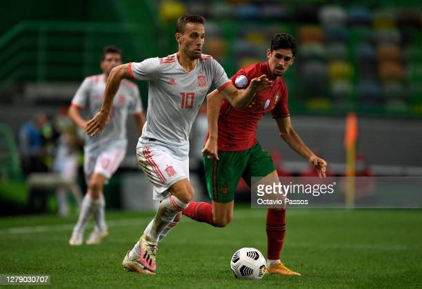 Sergio Canales of Spain is challenged by Franisco Trincao of Portugal during the international friendly match between Portugal and Spain at Estadio...
