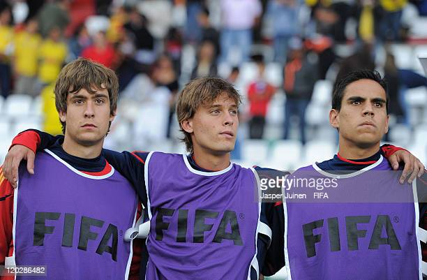 Sergio Canales of Spain stands with his teammates as they listen to their countries national anthem during the FIFA U20 World Cup Colombia 2011 group...