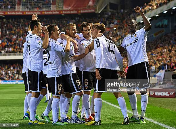 Sergio Canales of Valencia celebrates with his teammates after scoring his team's fourth goal during the La Liga match between Valencia CF and Malaga...