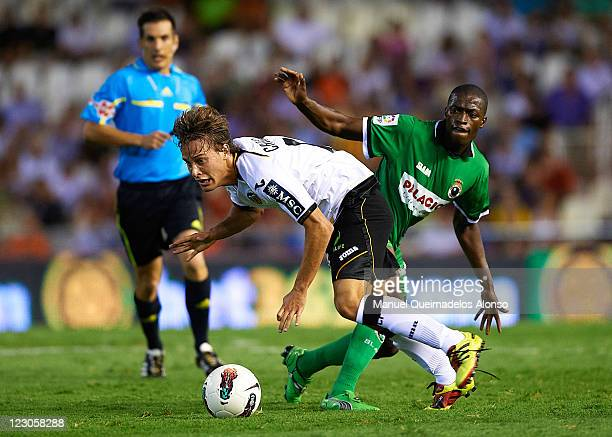 Sergio Canales of Valencia duels for the ball with Papakouly Diop of Racing de Santander during the La Liga match between Valencia and Racing de...