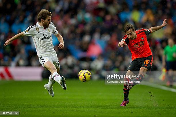 Sergio Canales Real Sociedad de Futbol competes for the ball with Asier Illarramendi of Real Madrid CF during the La Liga match between Real Madrid...