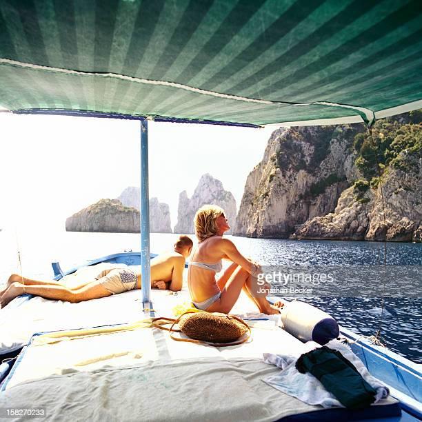 Sergio Cappelli and Fiamma De Sanctis are photographed for Vanity Fair Magazine on September 10 2000 on Maurizio Siniscalco's gozzo in Capri Italy...