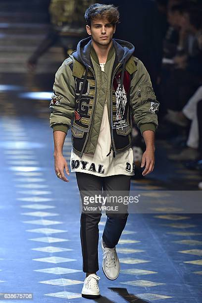 Sergio Carvajal walks the runway at the Dolce Gabbana show during Milan Men's Fashion Week Fall/Winter 2017/18 on January 14 2017 in Milan Italy