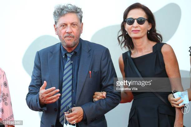 "Sergio Castellitto and Margaret Mazzantini walk the red carpet ahead of the movie ""I Predatori"" at the 77th Venice Film Festival on September 11,..."