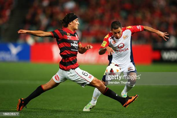 Sergio Cirio of Adelaide competes with Jerome Polenz of the Wanderers during the round four ALeague match between the Western Sydney Wanderers and...