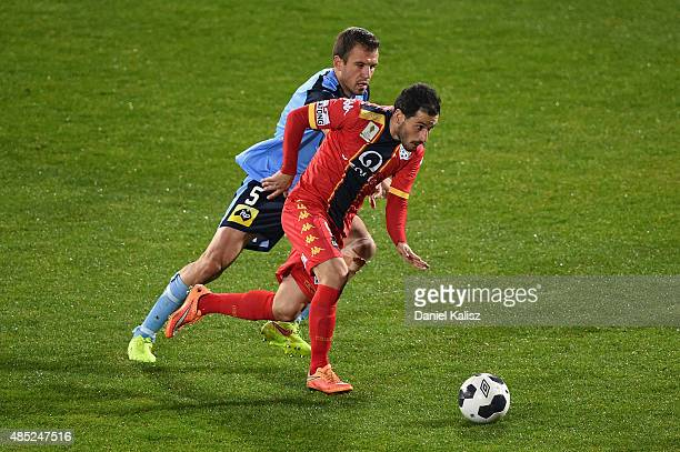 Sergio Cirio of United competes for the ball against Matthew Jurman of Sydney during the FFA Cup Round of 16 match between Adelaide United and Sydney...