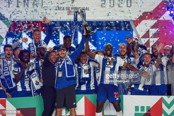 Sergio Conceicao Iker Casillas Danilo Pereira and FC Porto players rise the trophy after winning the Portuguese Cup Final match between SL Benfica...