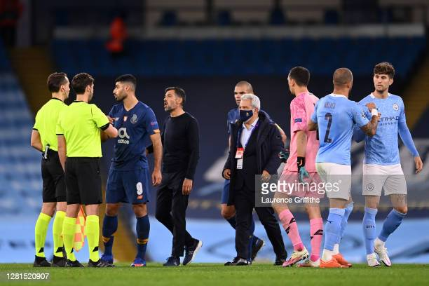Sergio Conceicao, Manager of FC Porto confronts referee Andris Treimanis following the UEFA Champions League Group C stage match between Manchester...
