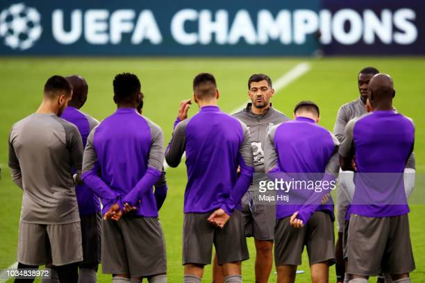 Sergio Conceicao manager of FC Porto speaks with his players during an FC Porto training session on the eve of their UEFA Champions League match...