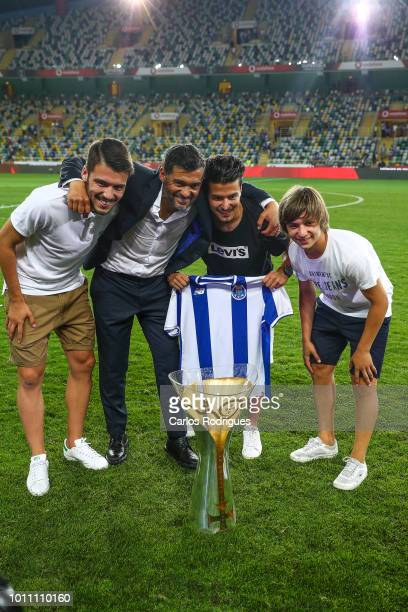 Sergio Conceicao of FC Porto celebrates wining the Portuguese SuperCup with his kinds during the match between FC Porto and Desportivo das Aves for...