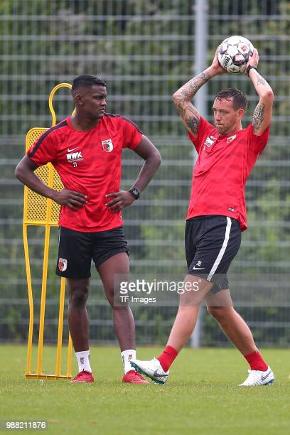 Sergio Cordova of Augsburg and Julian Schieber of Augsburg look on during a FC Augsburg Training session on June 28 2018 in Augsburg Germany