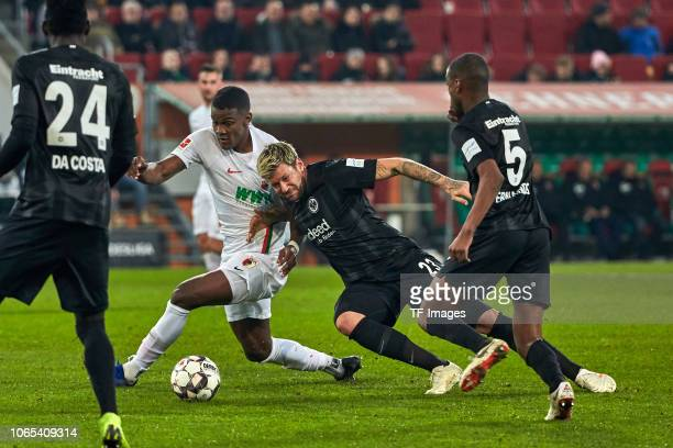 Sergio Cordova of Augsburg and Marco Russ of Frankfurt battle for the ball during the Bundesliga match between FC Augsburg and Eintracht Frankfurt at...