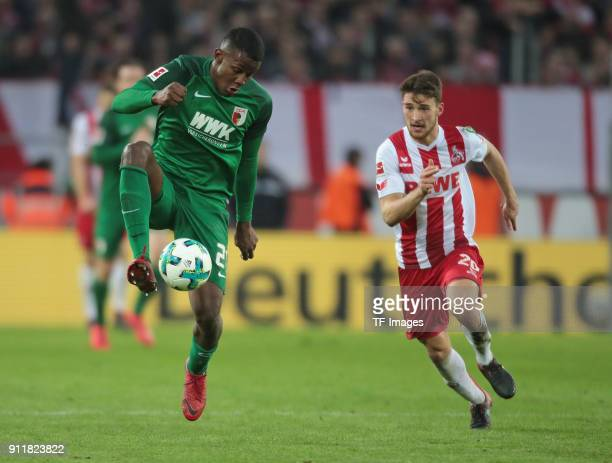 Sergio Cordova of Augsburg and Salih Oezcan of Koeln battle for the ball during the Bundesliga match between 1 FC Koeln and FC Augsburg at...