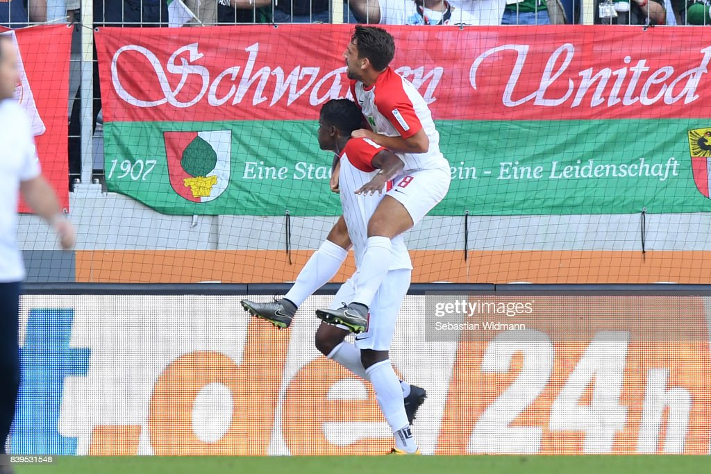 Sergio Cordova of Augsburg celebrates his teams second goal to make it 2:2 with Rani Khedira of Augsburg (top) during the Bundesliga match between FC Augsburg and Borussia Moenchengladbach at WWK-Arena on August 26, 2017 in Augsburg, Germany.