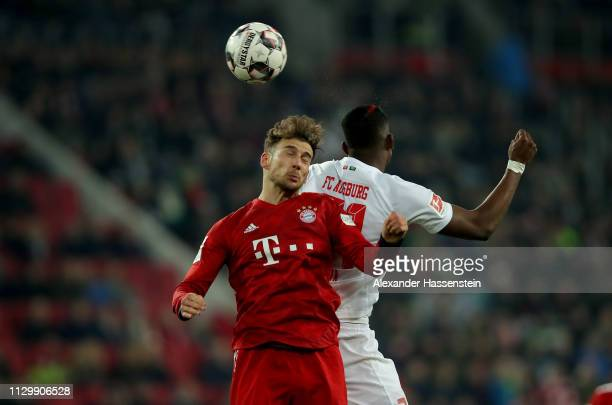 Sergio Cordova of Augsburg challenges Leon Goretzka of Muenchen during the Bundesliga match between FC Augsburg and FC Bayern Muenchen at WWKArena on...