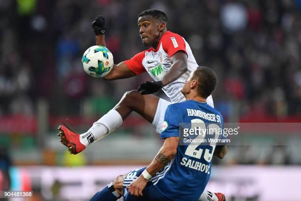 Sergio Cordova of Augsburg fights for the ball with Sejad Salihovic of Hamburg during the Bundesliga match between FC Augsburg and Hamburger SV at...
