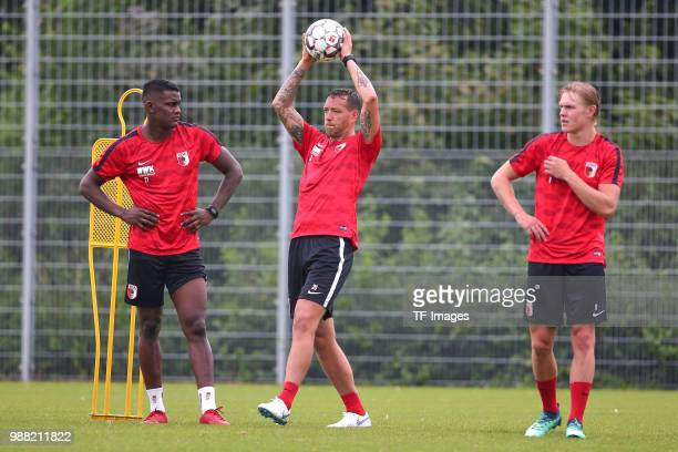 Sergio Cordova of Augsburg Julian Schieber of Augsburg and Fredrik Jensen of Augsburg look on during a FC Augsburg Training session on June 28 2018...