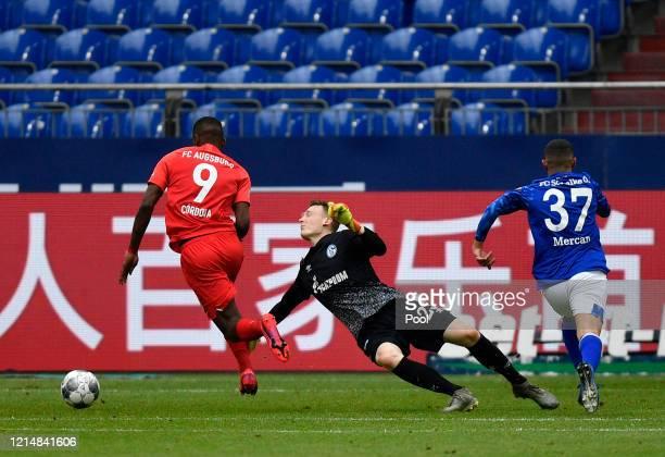 Sergio Cordova of Augsburg runs past Markus Schubert of FC Schalke 04 to score his team's third goal during the Bundesliga match between FC Schalke...