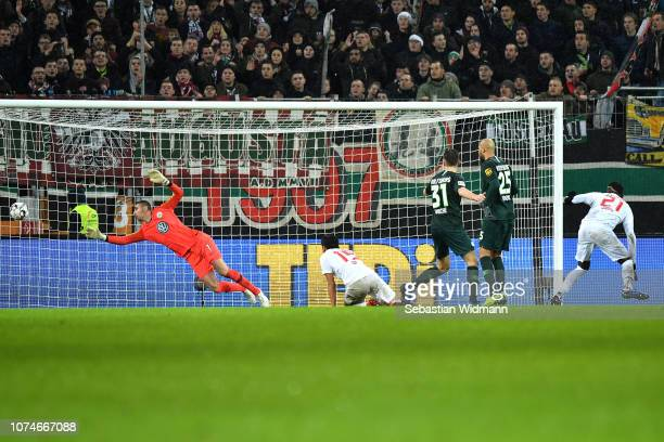 Sergio Cordova of Augsburg scores his sides second goal during the Bundesliga match between FC Augsburg and VfL Wolfsburg at WWKArena on December 23...