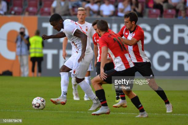 Sergio Cordova of FC Augsburg Inigo Cordoba of Athletic Bilbao and Inigo Lekue of Athletic Bilbao battle for the ball during the friendly match...