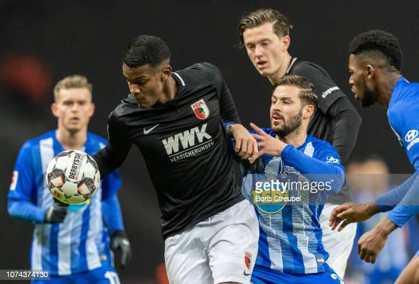 Sergio Cordova of FC Augsburg is challenged by Marvin Plattenhardt of Hertha BSC during the Bundesliga match between Hertha BSC and FC Augsburg at...