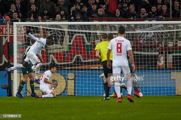 Sergio Cordova of FC Augsburgscores the team's second goal during the Bundesliga match between FC Augsburg and VfL Wolfsburg at WWKArena on December...