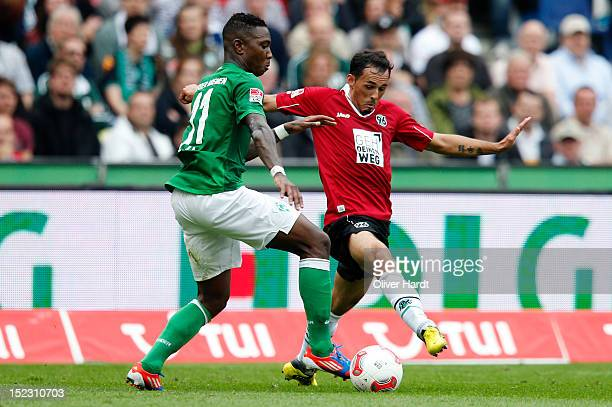 Sergio Da Silva Pinto of Hannover and Eljero Elia of Bremen battle for the ball during the 1 Bundesliga match between Hannover 96 and Werder Bremen...