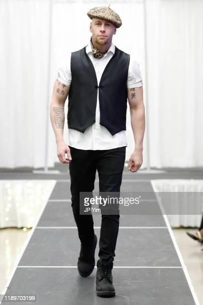 Sergio Delavicci walks the runway at the FTM Fashion Week S7 at Sturgeon City on November 23 2019 in Jacksonville North Carolina