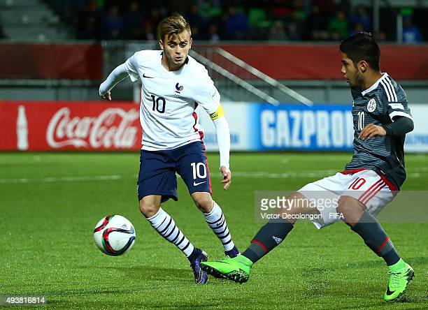 Sergio Diaz of Paraguay chips the ball past Timothe Cognat of France during the Paraguay v France Group F FIFA U17 World Cup Chile 2015 match at...