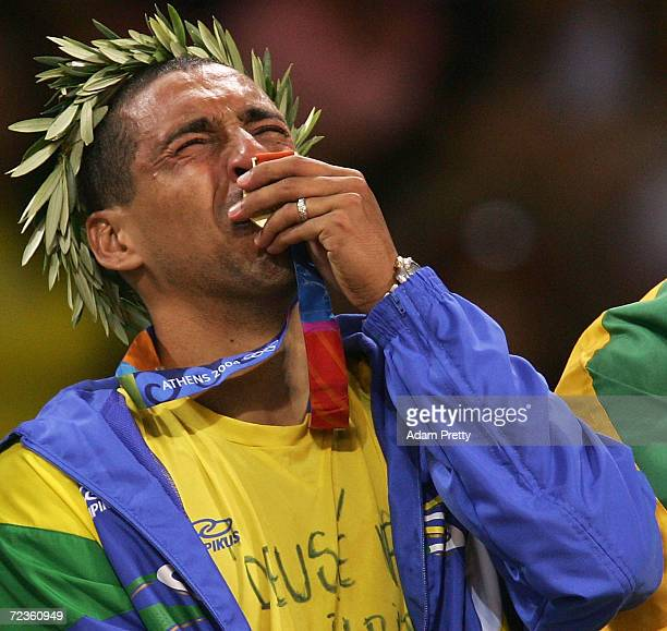 Sergio Dutra Santos of Brazil cries as he kisses the gold medal for men's indoor Volleyball during ceremonies on August 29 2004 during the Athens...