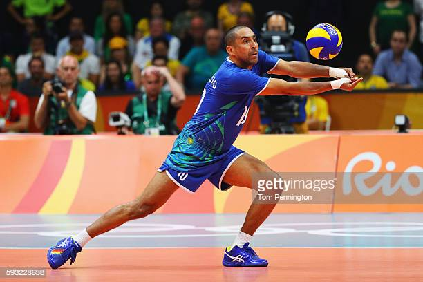 Sergio Dutra Santos of Brazil sets the ball during the Men's Gold Medal Match between Italy and Brazil on Day 16 of the Rio 2016 Olympic Games at...