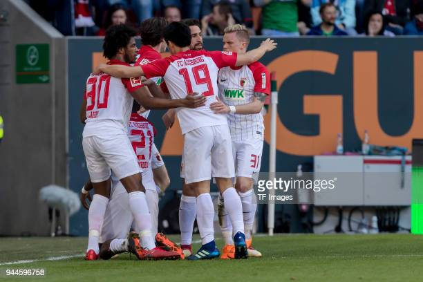 Sergio Duvan Cordova Lezama of Augsburg celebrates after scoring his team`s first goal with team mates during the Bundesliga match between FC...