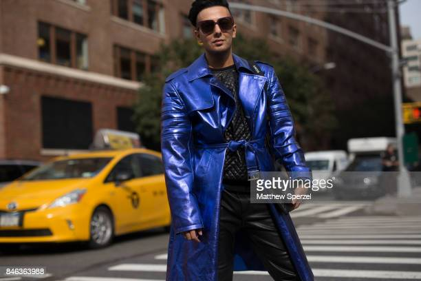 Sergio ElAzzi is seen attending NaeeM Khan and Chiara Boni La petite Rose during New York Fashion Week wearing a black outfit with blue coat on...