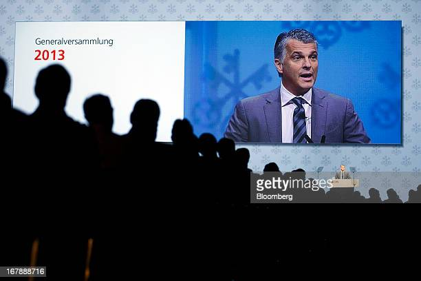 Sergio Ermotti chief executive officer of UBS AG is seen on a large video screen as he speaks during the bank's annual general meeting in Zurich...