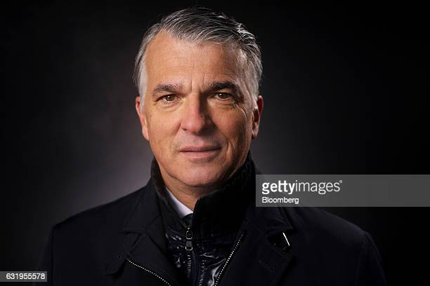 Sergio Ermotti chief executive officer of UBS AG poses for a photograph following a Bloomberg Television interview at the World Economic Forum in...