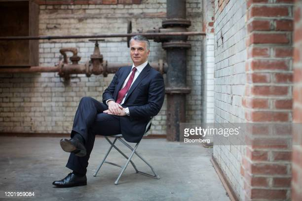 Sergio Ermotti, chief executive officer of UBS AG, poses for a photograph at the launch of WOMEN: New Portraits exhibition at Wapping Hydraulic Power...