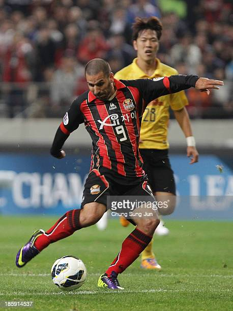 Sergio Escudero of FC Seoul in action as score during the AFC Champions League Final 1st leg match between FC Seoul and Guangzhou Evergrande at Seoul...