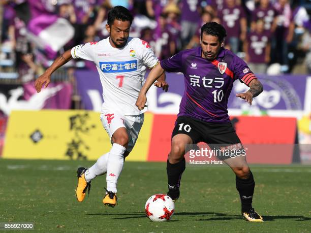 Sergio Escudero of Kyoto Sanga and Yuto Sato of JEF United Chiba compete for the ball during the JLeague J2 match between Kyoto Sanga and KEF United...