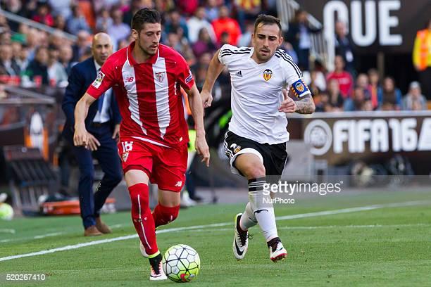 18 Sergio Escudero of Sevilla CF and 09 Paco Alcacer of Valencia CF during La Liga match between Valencia CF and Sevilla CF at Mestalla Stadium in...
