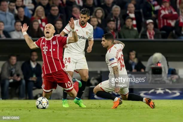Sergio Escudero of Sevilla Ever Banega of Sevilla and Arjen Robben of Muenchen battle for the ball during the UEFA Champions League quarter final...