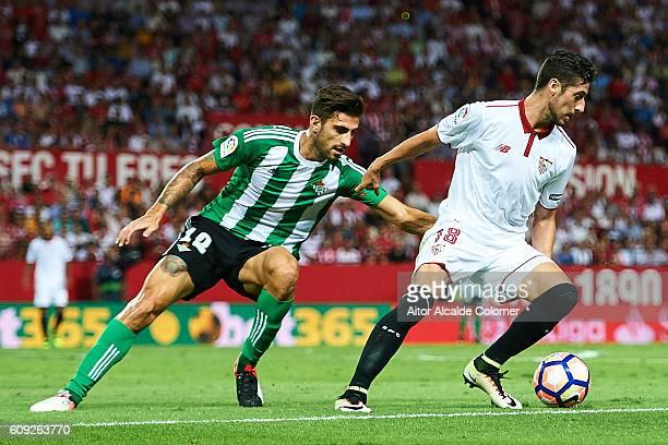 Sergio Escudero of Sevilla FC being followed by Cristiano Piccini of Real Betis Balompie during the match between Sevilla FC vs Real Betis Balompie...