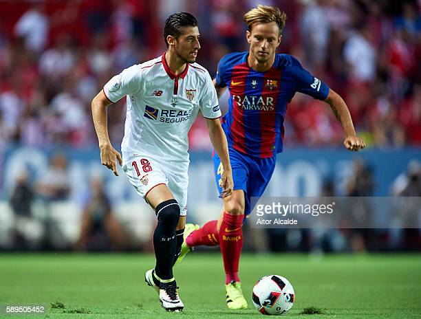 Sergio Escudero of Sevilla FC being followed by Ivan Rakitic of FC Barcelona during the match between Sevilla FC vs FC Barcelona as part of the...